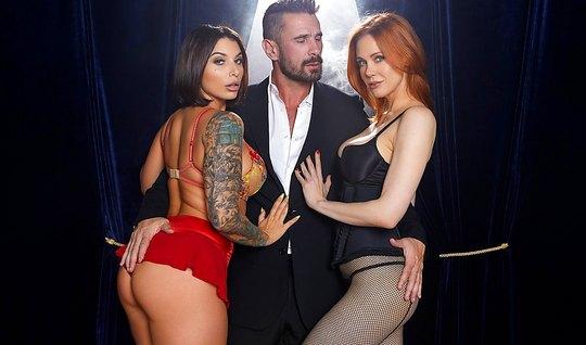 Татуированная брюнетка и рыжая красотка занимаются групповым сексом с брюнетом