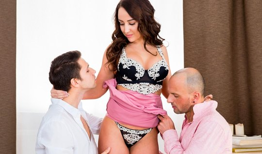 Russian brunette in the arms of two men experiencing pleasure from double penetration
