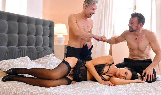 Two guys made a real double penetration for a brunette in stockings