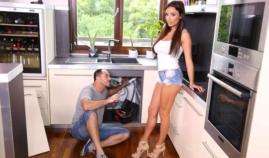 The brunette lowered her vaginal shorts with a plumber in the kitchen