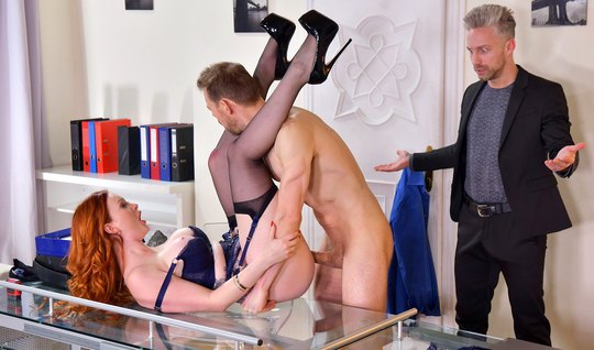Redhead girl in the office lifts her legs in stockings for group sex