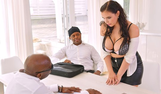 Two blacks stroke the big tits of a white assistant and want to fuck her in all holes