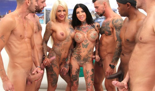 Lumberjack crowd fucks two tattooed girls at orgy and makes them cum
