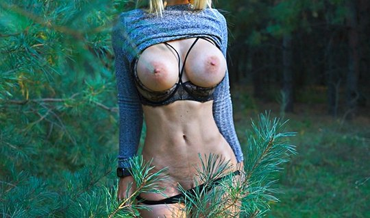 A cowboy crumples big tits of a blonde in nature and fucks doggystyle in a pussy