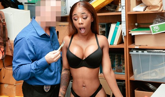 The mulatto in the office spreads her legs in front of the guard and cums