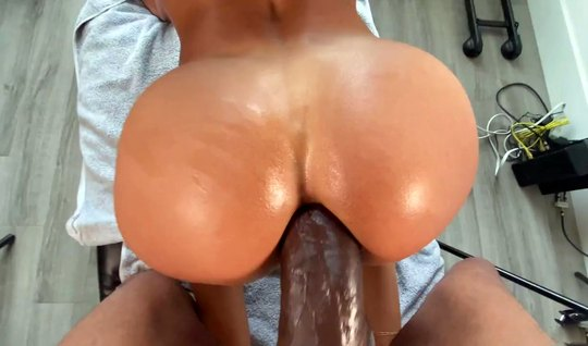 A negro with a big dick hard pounds a girl in the anal and brings her to orgasm