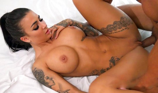 A girl with big tits and a tattoo on her body substitutes her pussy for sex