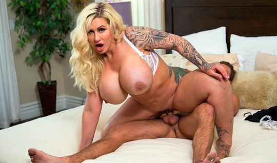 Tattooed mom with big tits rides lovers cock and cums