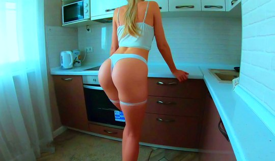 The blonde lowers her panties, showed a big ass and got up doggy style not against home porn